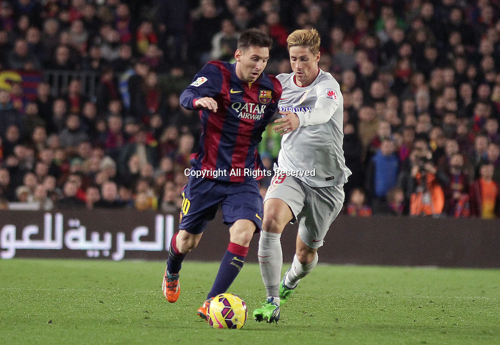11.01.2015. Barcelona, Spain. La liga football. Barcelona versus Atletico Madrid.  Messi in action challenged by Torres