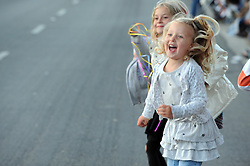 Excited children watch Saturday's 2013 Colmo del Rodeo Parade pass down South Main Street in Salinas.