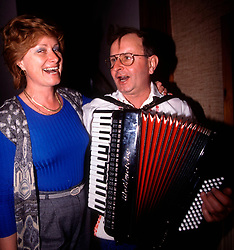 CZECH REPUBLIC MORAVIA BANOV APR98 - Anicka Benickova (L) sings with Jiri Chovanec during his visit to her home during Easter 98.  During Easter, folklore dress, music and mutual visits are part of the customary traditional celebrations in Moravia.  jre/Photo by Jiri Rezac<br /> <br /> &copy; Jiri Rezac 1998<br /> <br /> Tel:   +44 (0) 7050 110 417<br /> Email: info@jirirezac.com<br /> Web:   www.jirirezac.com
