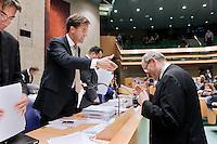 Nederland. Den Haag, 27 oktober 2010.<br /> De Tweede Kamer debatteert over de regeringsverklaring van het kabinet Rutte.<br /> Job Cohen buigt voor Mark Rutte bij vak K, na een schorsing. Links : Maxime Verhagen. oppositie<br /> Kabinet Rutte, regeringsverklaring, tweede kamer, politiek, democratie. regeerakkoord, gedoogsteun, minderheidskabinet, eerste kabinet Rutte, Rutte1, Rutte I, debat, parlement<br /> Foto Martijn Beekman