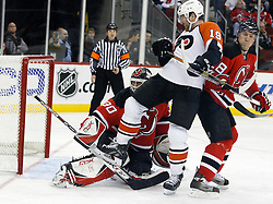 November 8, 2007; Newark, NJ, USA;  New Jersey Devils goalie Martin Brodeur (30) and New Jersey Devils defenseman Sheldon Brookbank (8) battle with Philadelphia Flyers left wing Scott Hartnell (19) during the first period at the Prudential Center in Newark, NJ.