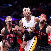 30 November 2014: Los Angeles Lakers center Jordan Hill (27) vies for the rebound with Toronto Raptors forward Terrence Ross (31) and Toronto Raptors forward James Johnson (3) during the Los Angeles Lakers 129-122 overtime victory over the Toronto Raptors, at the Staples Center, Los Angeles, California, USA.