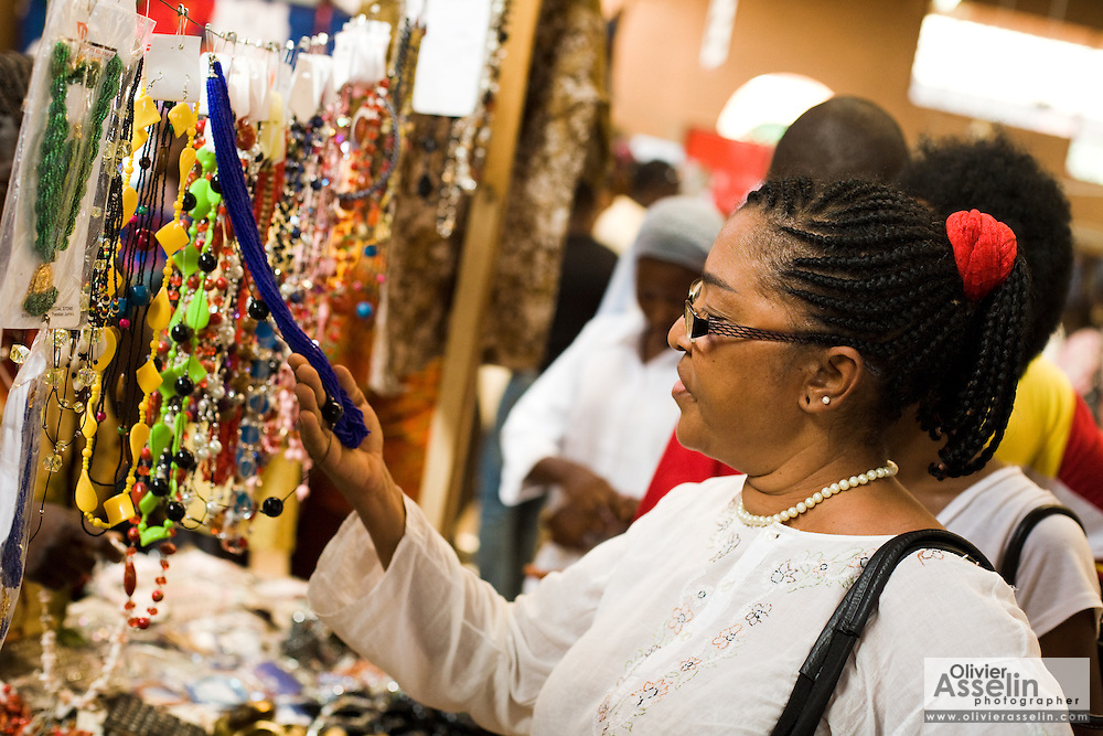 A visitor looks at jewelry at the 22nd Salon International de l'Artisanat de Ouagadougou (SIAO) in Ouagadougou, Burkina Faso on Sunday November 2, 2008.