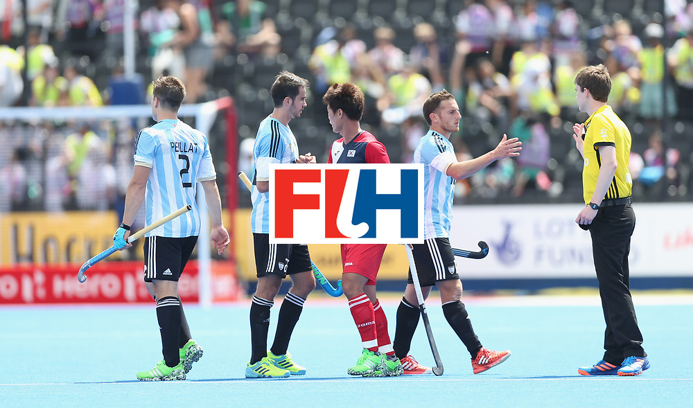 LONDON, ENGLAND - JUNE 15:  Players shake hands after the Hero Hockey World League Semi Final match between Korea and Argentina at Lee Valley Hockey and Tennis Centre on June 15, 2017 in London, England.  (Photo by Alex Morton/Getty Images)