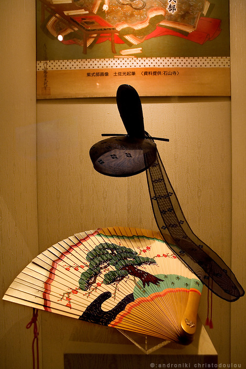 "Fan and hat as those used by the court nobles at the time when ""The Tale of Genji"" was written, a 1000 years ago, in the Genji museum of Uji city south of Kyoto...."