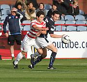 Dundee's Paul McGinn and Hamilton's Daniel Redmond - Dundee v Hamilton, SPFL Premiership at Dens Park<br /> <br />  - &copy; David Young - www.davidyoungphoto.co.uk - email: davidyoungphoto@gmail.com