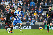 Arsenal defender Shkodran Mustafi (20) battles with Brighton and Hove Albion midfielder Pascal Gross (13) during the Premier League match between Brighton and Hove Albion and Arsenal at the American Express Community Stadium, Brighton and Hove, England on 4 March 2018. Picture by Phil Duncan.
