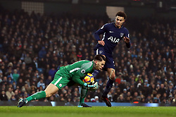 Manchester City goalkeeper Ederson collides with Tottenham Hotspur's Dele Alli during the Premier League match at the Etihad Stadium, Manchester.