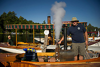 Joe Spadoni from Washington State lets off some steam from his 20' Steam Launch with single cylinder engine before making the trek to 19 Mile Bay in Tuftonboro on Wednesday.  (Karen Bobotas/for the Laconia Daily Sun)
