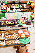 Cute figurines and and signs at a roadside shop, Udon Thani