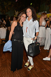 Left to right, LILY HODGES and LILLY BECKER at a tea party to launch Grace Guru held at Sketch, 9 Conduit Street, London on 17th June 2015.