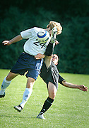 (boot to head)  --  Whitman College midfielder Joe Johnson (24) comes dangerously close to taking a boot to the head from Pacific Lutheran University's Peter Thomas (13) during the first half of their Sunday afternoon game. Thomas was called for a foul on the play because of the dangerous high kick.        (10/1/06)        MZ Photo