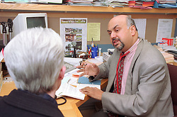 Male doctor talking with patient in surgery,