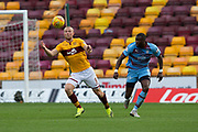 3rd November 2018, Fir Park, Motherwell, Scotland; Ladbrokes Premiership football, Motherwell versus Dundee; Curtis Main of Motherwell and Genserix Kusunga of Dundee