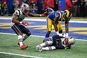 New England Patriots defensive back Jonathan Jones (31) looks on as Patriots cornerback Stephon Gilmore (24) is touched down after intercepting a late fourth quarter pass intended for Los Angeles Rams wide receiver Brandin Cooks (12) at the Patriots 4 yard line during the NFL Super Bowl 53 football game on Sunday, Feb. 3, 2019, in Atlanta. The Patriots defeated the Rams 13-3. (©Paul Anthony Spinelli)