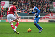 Queens Park Rangers midfielder Junior Hoilett and Bristol City defender Luke Ayling during the Sky Bet Championship match between Bristol City and Queens Park Rangers at Ashton Gate, Bristol, England on 19 December 2015. Photo by Jemma Phillips.