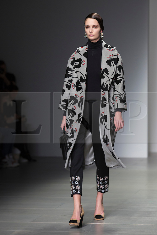 © Licensed to London News Pictures. 15 February 2014. London, England, UK. A model walks the runway at the Holly Fulton show during London Fashion Week AW14 at the BFC Courtyard Show Space/Somerset House. Photo credit: Bettina Strenske/LNP