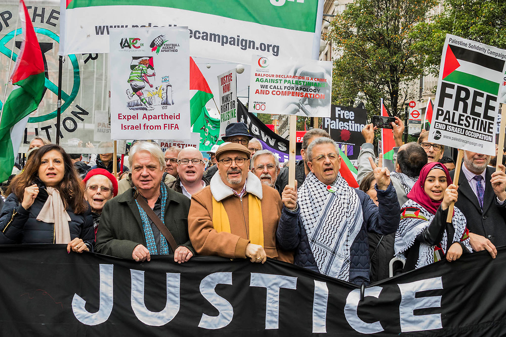 Marching down Oxford Street - National Palestine March and Rally - Justice Now: Make it right for Palestine. As the centenary of the Balfour Declaration has just passed on the 2nd November. Speakers addressed the crowd at Grosvenor Square (by the US Embassy) before the march through central London (via Piccadilly Circus and Trafalgar Square). This was followed by a rally in Parliament Square, where speakers again addressed the crowd.