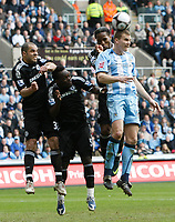 Photo: Steve Bond/Richard Lane Photography.<br />Coventry City v Chelsea. FA Cup 6th Round. 07/03/2009. Ben Turner (R) attacks. Alex (L) Michael Essien (CL) and Didier Drogba (CR) defend