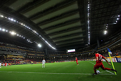Paul Reid of Adelaide United takes a corner inside the Tokyo Stadium with its rood shut