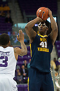 FORT WORTH, TX - JANUARY 4: Devin Williams #41 of the West Virginia Mountaineers shoots the ball against the TCU Horned Frogs on January 4, 2016 at Ed and Ray Schollmaier Arena in Fort Worth, Texas.  (Photo by Cooper Neill/Getty Images) *** Local Caption *** Devin Williams
