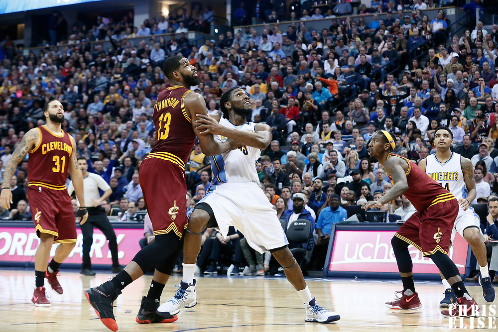 22 March 2017: Denver Nuggets forward Kenneth Faried (35) vies for the rebound with Cleveland Cavaliers center Tristan Thompson (13) during the Denver Nuggets 126-113 victory over the Cleveland Cavaliers, at the Pepsi Center, Denver, Colorado, USA.