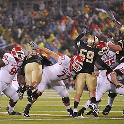 Oct 23, 2009; West Point, N.Y., USA; Rutgers defensive tackle Michael Larrow (90), offensive lineman Art Forst (77) and long snapper Andrew Depaola (16) block during a field goal attempt during Rutgers' 27 - 10 victory over Army at Michie Stadium.