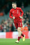 Liverpool midfielder James Milner (7) warming up during the Premier League match between Liverpool and Everton at Anfield, Liverpool, England on 4 December 2019.
