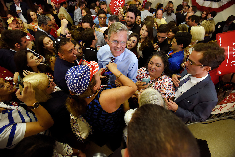 Roxanna Greene of Hialeah straightens Presidential candidate and former Governor of Florida Jeb Bush's tie while Bush greeted supporters after speaking during a campaign stop Monday, Nov. 2, 2015 in Tampa.