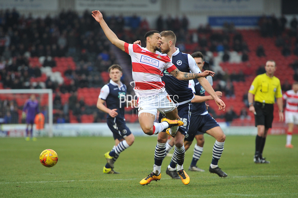 Nathan Tyson of Doncaster Rovers loses ball after tackel from Mark Beevers of Millwall FC  during the Sky Bet League 1 match between Doncaster Rovers and Millwall at the Keepmoat Stadium, Doncaster, England on 27 February 2016. Photo by Ian Lyall.