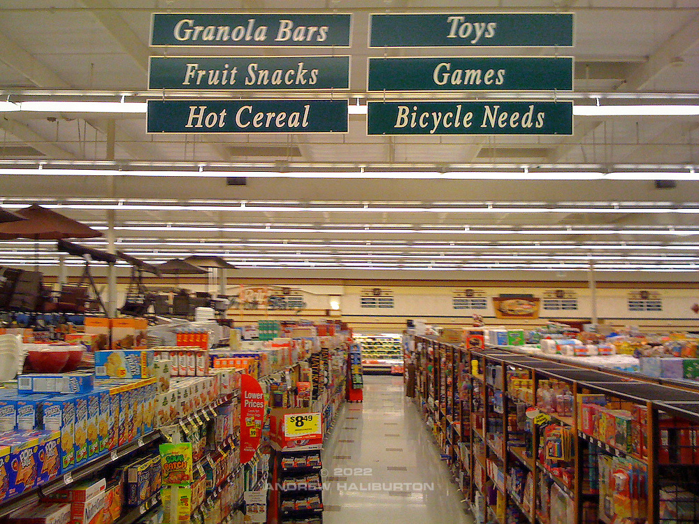 Bicycle Needs - aisle sign in Ralphs Supermarket, Palm Springs. United Finance (formerly Finnegan's Toys / Discover Chiropractic) Cycling Team winter training camp, January 30 to February 5, 2010; Palm Springs, California.  Emerald Velo Cycling Club (EVCC).