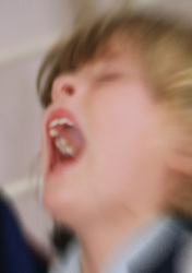 Young girl screaming in pain,