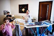 Napoli, Italia - 11 dicembre 2010. La signora Antonietta Sarnataro e suo figlio  all'interno della loro casa/stanza nell'albergo Vergilius di Napoli..Ph. Roberto Salomone Ag. Controluce.ITALY - Antonietta Sarnataro and her son in their room/house in Vergilius hotel in Naples on December 11, 2010.