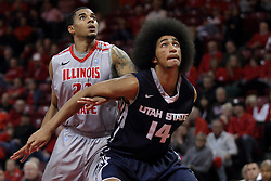 16 November 2014:  Deontae Hawkins gets blocked out by Jalen Moore at a free throw attempt during an NCAA non-conference game between the Utah State Aggies and the Illinois State Redbirds.  The Aggies win the competition 60-55 at Redbird Arena in Normal Illinois.