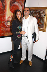 GILLES DYAN and his wife FLORENCE he is chairman of the Opera Gallery at the opening of the Opera Gallery in London, 134 New Bond Street, London W1 on 29th September 2005.<br />