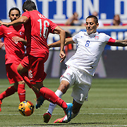 Clint Dempsey, (right), USA, challenges Ozan Tufan, Turkey, during the US Men's National Team Vs Turkey friendly match at Red Bull Arena.  The game was part of the USA teams three-game send-off series in preparation for the 2014 FIFA World Cup in Brazil. Red Bull Arena, Harrison, New Jersey. USA. 1st June 2014. Photo Tim Clayton