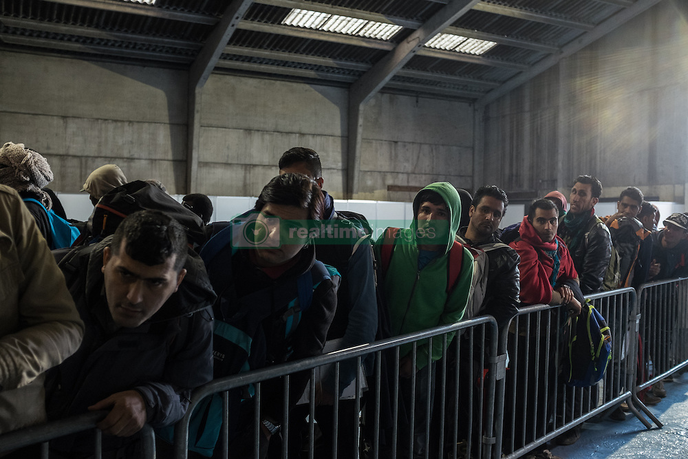 October 25, 2016 - Calais, France - Migrants are at the registration center at the Calais Jungle to register themselves and get into the buses they distribute in Calais, France, on 25 October 2016. Up to the evening, about 4,000 migrants from the Refugee camp on the coast at the English Channel were distributed to several regions in France. The police have begun to tear down the huts and tents in the camp. (Credit Image: © Markus Heine/NurPhoto via ZUMA Press)