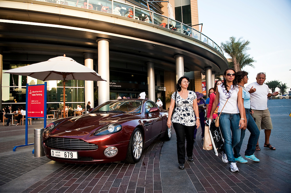 Expensive cars pull up to the valet parking area at Dubai Mall, in front of the Burj Khalifa, Dubai, UAE on Friday, February 12, 2010. Archive of images of Dubai by Dubai photographer Siddharth Siva
