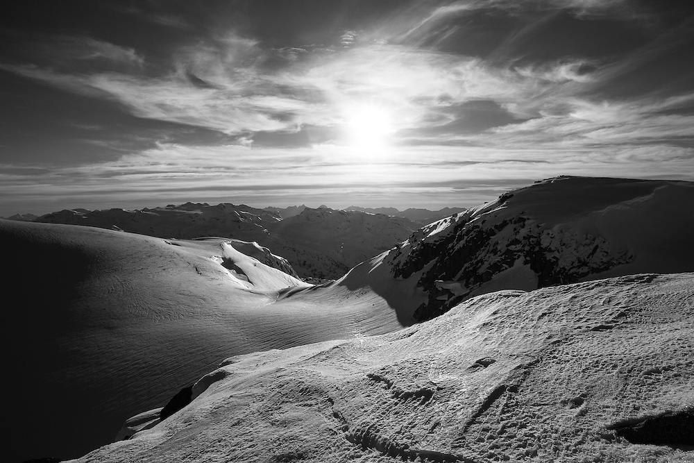 A black and white photo of the late afternoon sun looking south from the Pemberton Icecap, near Whistler, BC.