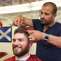 Scotland's Chairty Air Ambulance pilot Clark Priestly pictured at First Class Barber's in South Street Perth with owner Ferdi Gul during a haircut, beard trim, hair wash, hot towel and massage just some of the services that owner Ferdi Gul and his team will be offering to customers on Sunday 27th July when all proceeds from the day will be donated to SCAA....<br /> Picture by Graeme Hart.<br /> Copyright Perthshire Picture Agency<br /> Tel: 01738 623350  Mobile: 07990 594431