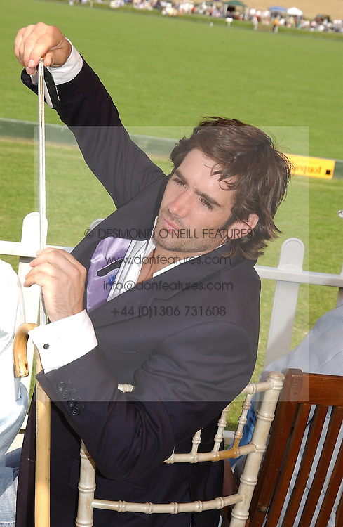 Polo player HENRY BRETT at the Veuve Clicquot sponsored Gold Cup or the British Open Polo Championship won by The  Azzura polo team who beat The Dubai polo team 17-9 at Cowdray Park, West Sussex on 18th July 2004.