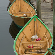 Gloucester, MA USA April, 14, 2015. Wooden dories built in Gloucster are rowed in the harbor my members of a rowing club.