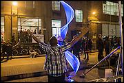 WAVE OUTSIDE THE ENTRANCE TO Kinetica Art Fair, Truman Building, Brick Lane, London. London. 16 October 2014