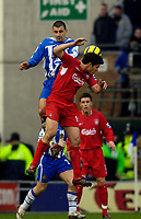 Photo: Jed Wee.<br />Wigan Athletic v Liverpool. The Barclays Premiership. 11/02/2006.<br />Wigan's Paul Scharner (L) jumps with Liverpool's Xabi Alonso.