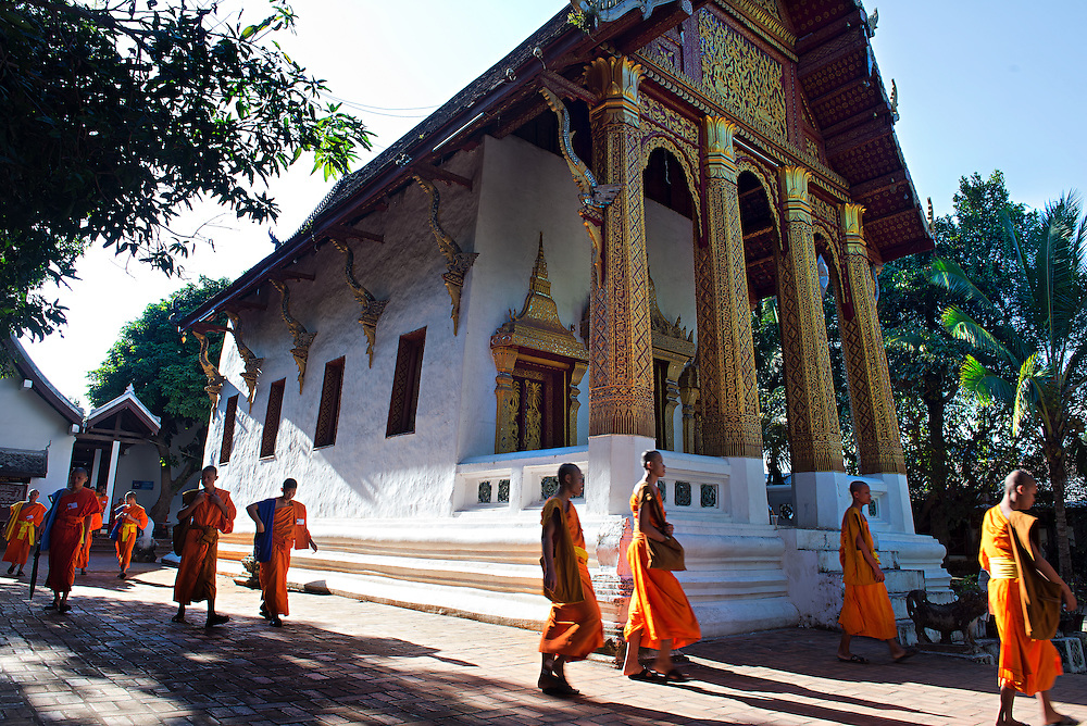 Novices leaving school at Wat Sensoikharam Luang Prabang, Laos.