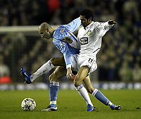 Photo. Aidan Ellis.<br /> Leeds United v Manchester City.<br /> FA Barclaycard Premiership.<br /> 22/03/2004.<br /> Leeds Jermaine Pennant and City's Antoine Sibierski