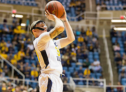 Nov 23, 2015; Morgantown, WV, USA; West Virginia Mountaineers guard Richard Romeo III shoots a three pointer during the first half  against the Bethune-Cookman Wildcats at WVU Coliseum. Mandatory Credit: Ben Queen-USA TODAY Sports