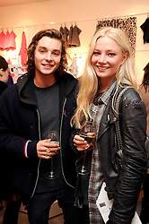CLARA PAGET and OSCAR TUTTIETT at the H&M Home Launch held at 174-176 Oxford Street, London W1 on 2nd November 2010.