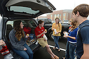 Daily Photo by Gary Cosby Jr.      Hartselle High students, teachers and administrators settle into the new high school Monday, April 1, 2013.  Nicholle Smith, Will Payne, Kayula Norwood, Mary Filiatrault and Greg Filiatrault enjoy a little first day tailgate in the parking lot before they enter the school.