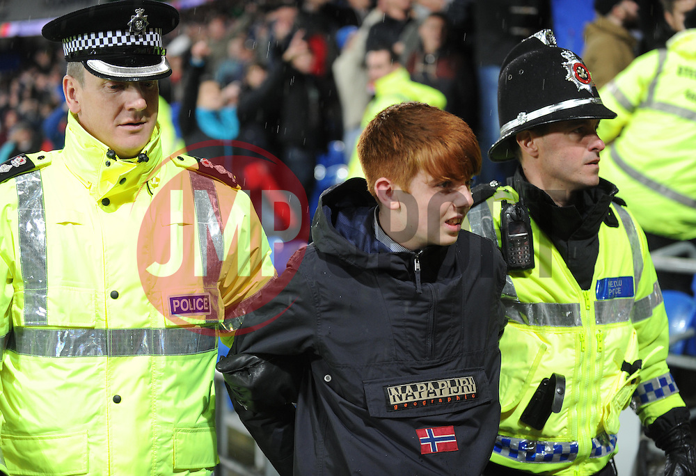 Young Swansea fan gets escorted by police. - Photo mandatory by-line: Alex James/JMP - Tel: Mobile: 07966 386802 03/11/2013 - SPORT - FOOTBALL - The Cardiff City Stadium - Cardiff - Cardiff City v Swansea City - Barclays Premier League